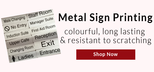 selection of assorted metal door signs